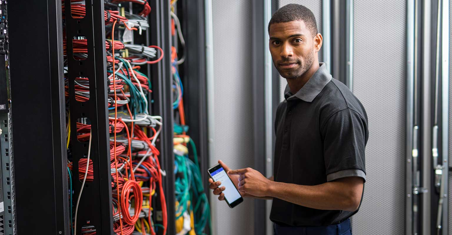 Network technician using Brother iLink&Label app on his smartphone