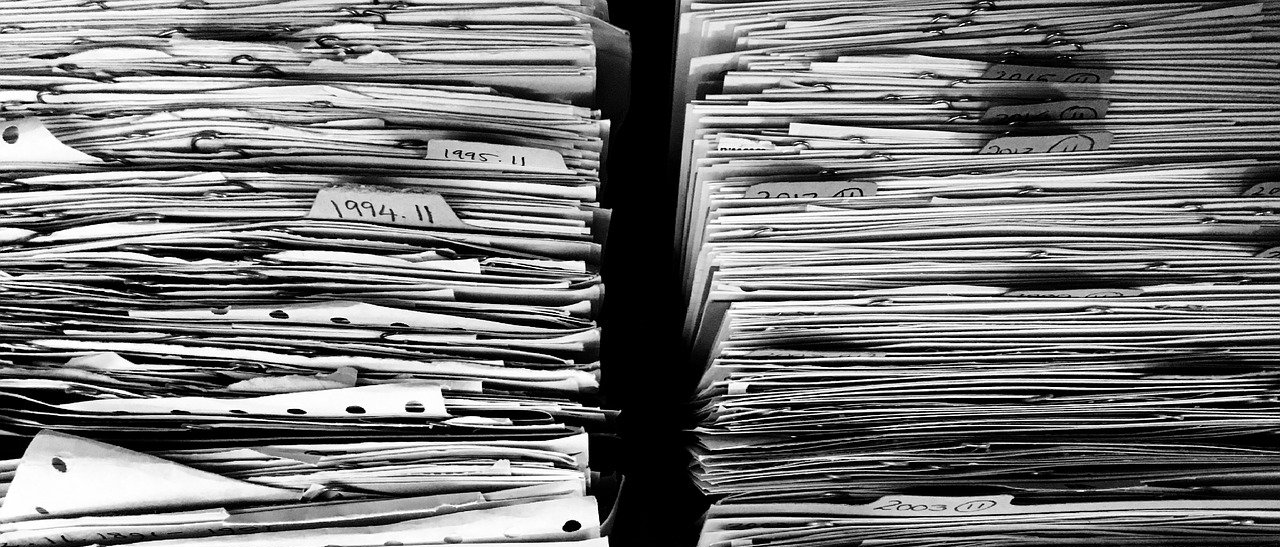 a black and white image of two stacks of paper filling up both sides of the image