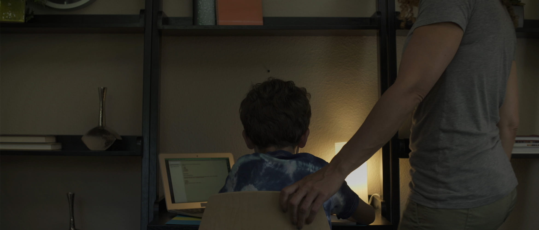 Mum helping son with homework
