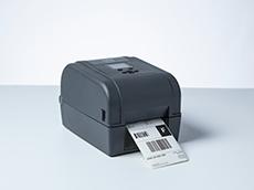 TD-4T desktop label printer printing shipping label