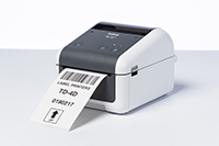 Brother TD-4520DN network desktop label printer printing label with barcode