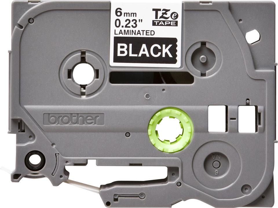 Oriģinālā Brother TZe315 baltas drukas melna uzlīmju lentes kasete, 6mm plata 2